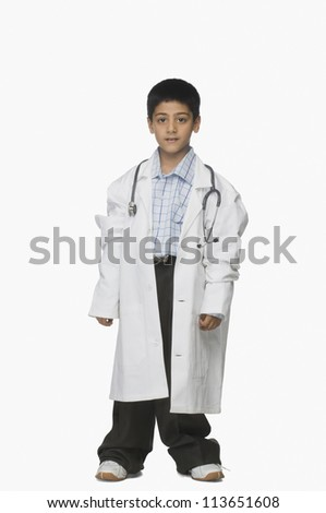 Portrait of a boy wearing lab coat and holding a stethoscope - stock photo
