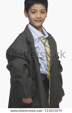 Portrait of a boy wearing oversized business clothing - stock photo