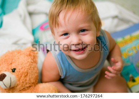 portrait of a boy with bear - stock photo