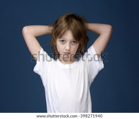 Portrait of a Boy with Blond Hair Looking  - stock photo