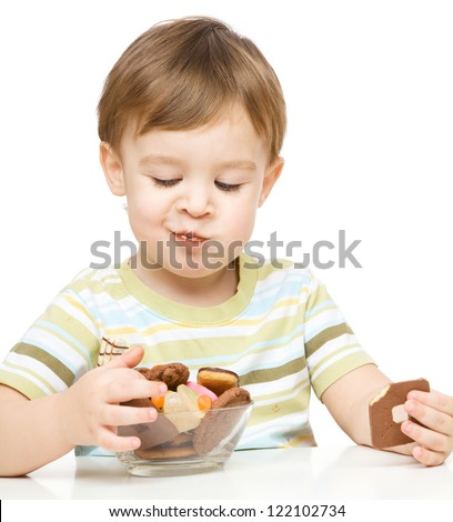 Portrait of a boy with cookies, isolated over white