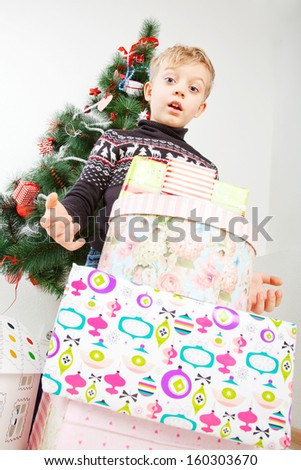 portrait of a boy with cristmas gift - stock photo