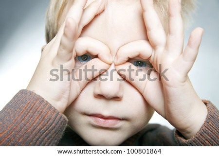 portrait of a boy with fun face and emotion - stock photo