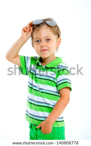 Portrait of a boy with sunglasses and wearing green clothing. Isolated on white background