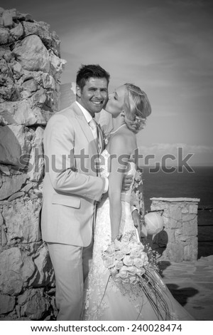 portrait of a bride and groom in a greek island on their wedding day
