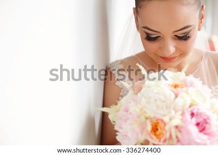 portrait of a bride in the studio - stock photo