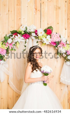 Portrait of a bride with wedding bouquet