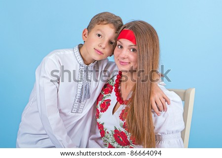 Portrait of a brother and sister in the Ukrainian national costume - stock photo