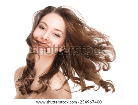 Portrait of a brunette beauty with strong healthy hair.