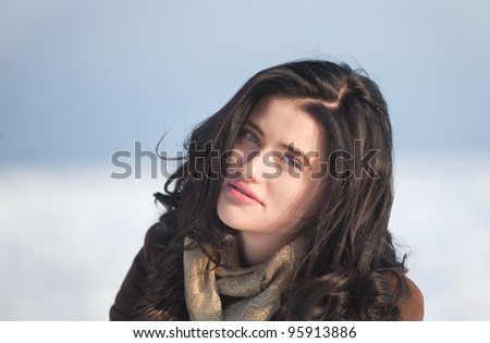 Portrait of a brunette girl in winter