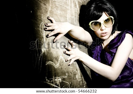 portrait of a brunette girl with sunglasses - stock photo