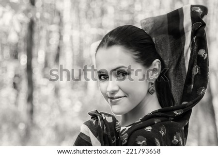 Portrait of a brunette in a forest.Enjoying the nature. Young woman enjoying the fresh air in green forest.