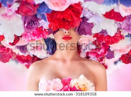 Portrait of a brunette lady in flowers - stock photo