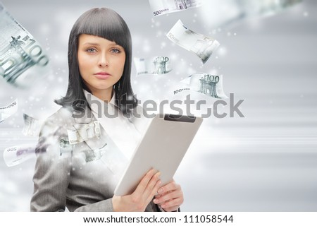 Portrait of a brunette woman with tablet computer - money appearing from the screen. Online commerce concept
