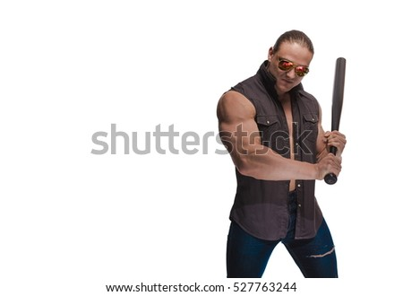 Portrait of a brutal man bodybuilder in sunglasses with a baseball bat on a white background