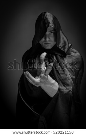 Portrait of a brutal man in a black robe