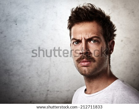 Portrait of a brutal man with a mustache