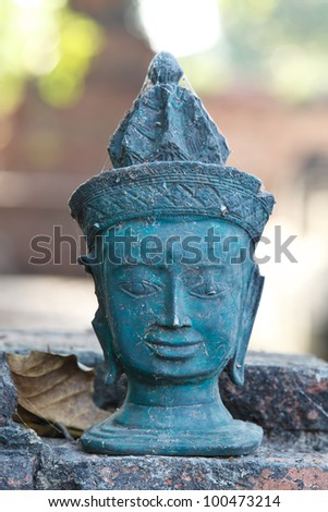 Portrait of a buddha ancient statues  at temple in Thailand. - stock photo