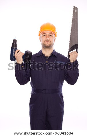 Portrait of a builder with a drill and a saw in his hands on a white background