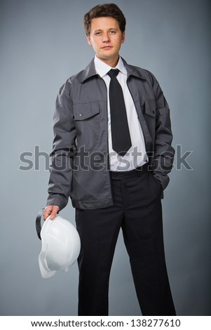 portrait of a builder with a helmet in the hand - stock photo