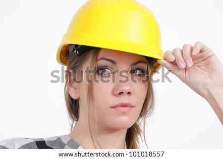 Portrait of a Builder woman on white