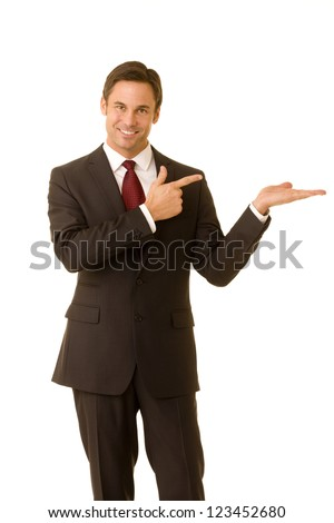 Portrait of a business executive pointing and extending his hand ready to place a product. - stock photo