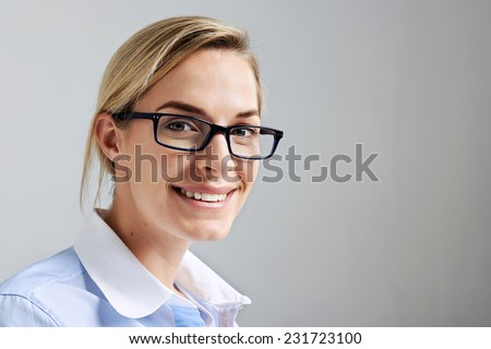 Portrait of a business intern woman with glasses smiling and happy - stock photo