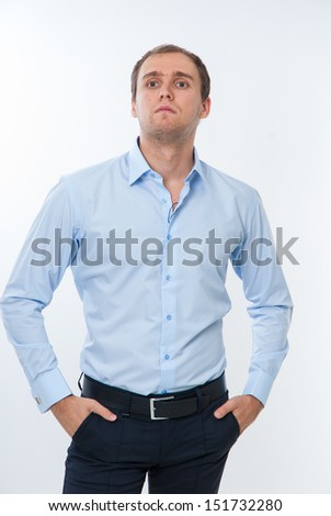 Portrait of a business man isolated on white background. Studio shot. Portrait of smiling young business man in a yellow shirt isolated on white background. Young man laughs isolation on white.
