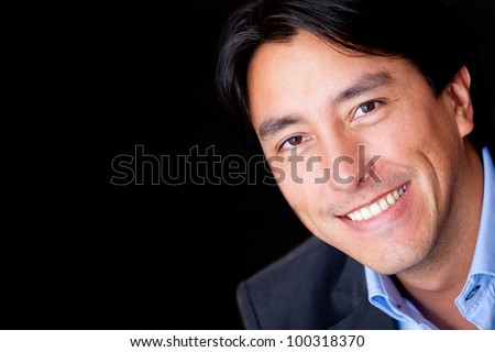 Portrait of a business man - isolated over a black background - stock photo