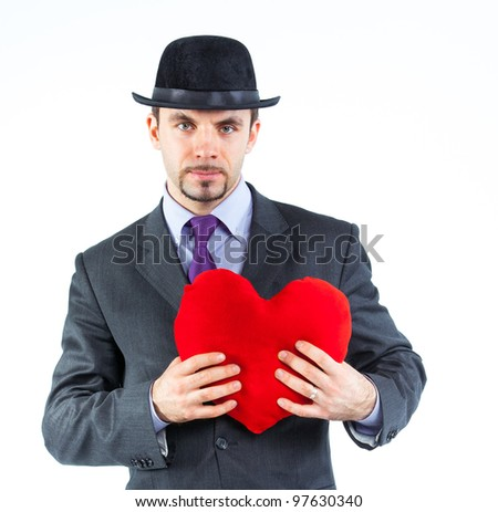 Portrait of a business man with hat and red heart isolated on white background. Studio shot.