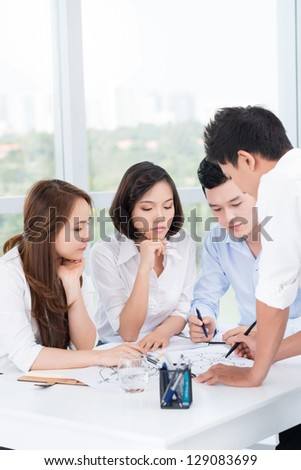 Portrait of a business team brainstorming at office