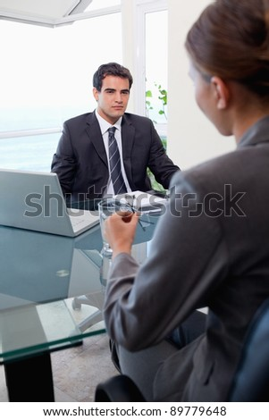 Portrait of a business team during a meeting in an office - stock photo