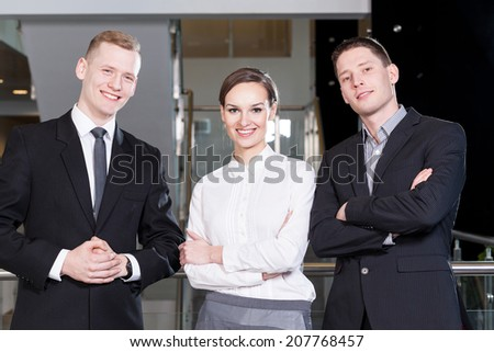 Portrait of a business team standing with arms crossed