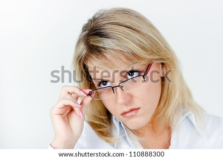 Portrait of a business woman blonde in glasses - stock photo