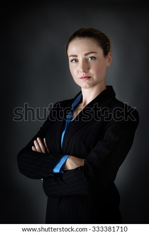 portrait of a business woman done in the studio with low key lighting - stock photo