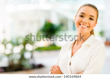 Portrait of a business woman looking very happy - stock photo