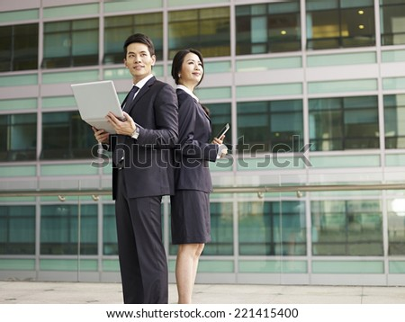 portrait of a businessman and a businesswoman. - stock photo