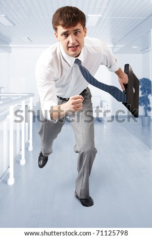 Portrait of a businessman being late for meeting - stock photo