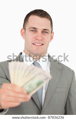 Portrait of a businessman giving notes against a white background - stock photo