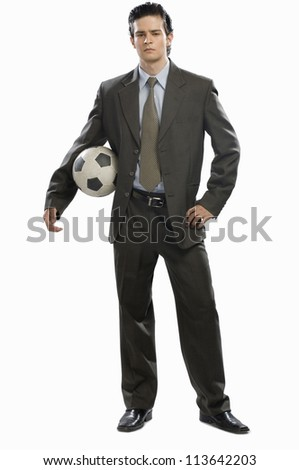 Portrait of a businessman holding a soccer ball