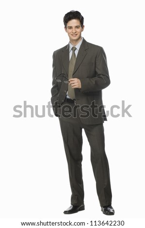 Portrait of a businessman holding his eyeglasses - stock photo