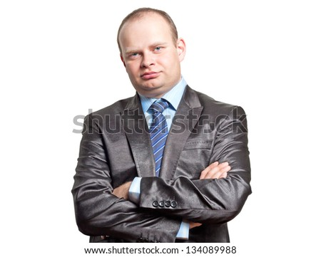 Portrait of a businessman in a black suit isolated on white background