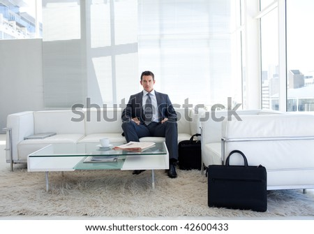 Portrait of a businessman in a waiting room. Business concept.