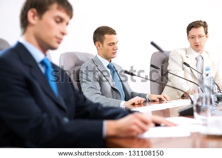Portrait of a businessman, in the background colleagues communicate with each other