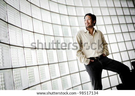 Portrait of a businessman looking at the window - stock photo