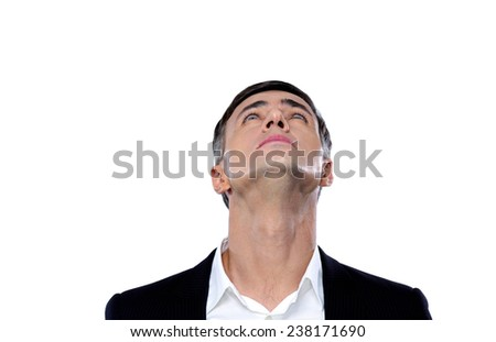 Portrait of a businessman looking up at copyspace - stock photo