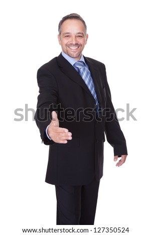 Portrait Of A Businessman Offering Handshake On White Background - stock photo