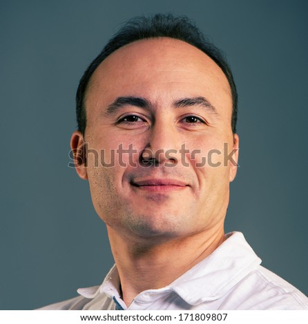 Portrait of a businessman on a dark background, closeup, age 35-40 years