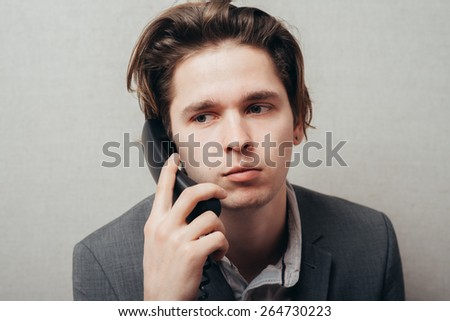Portrait of a businessman on phone in his office