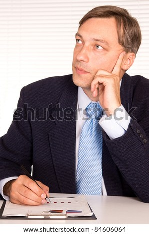 portrait of a businessman posing at office